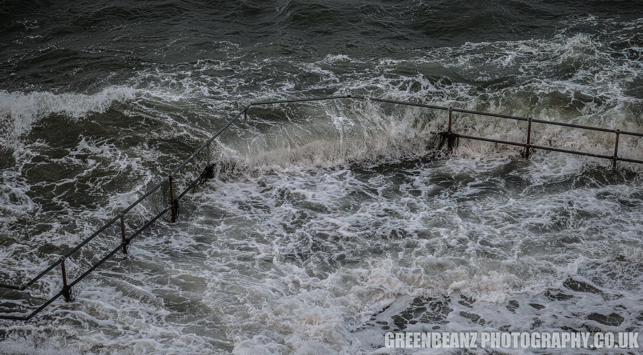 Waves crashing thru railings on Plymouth Hoe during Storm Brian 2017