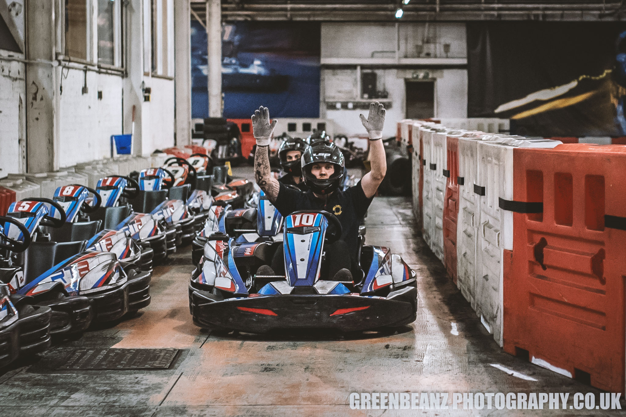 Winning Driver raises his hands in celebration at  Plymouth Karting