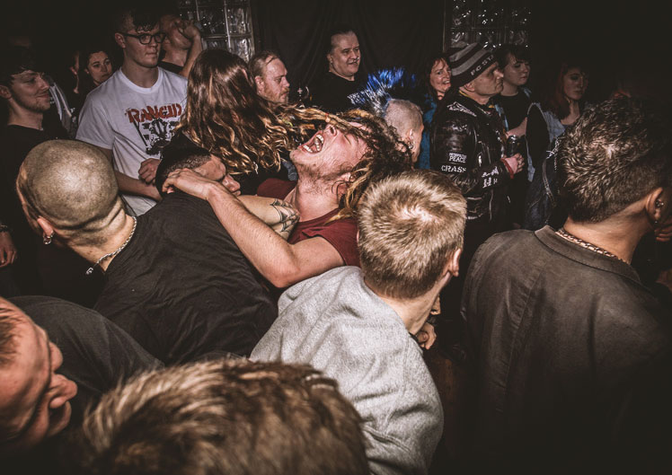 Plymouth Music Photograph of dreadlocked fan in the middle of a mosh pit at a live gig The undergorund Plymouth